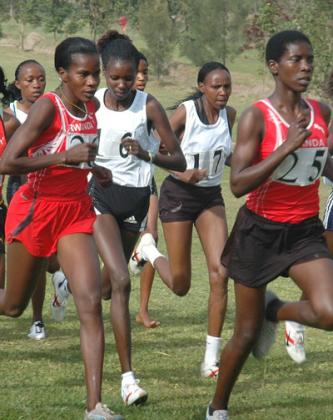 Epiphanie Nyirabarame, #26 has dominated Rwanda's long  distance for the past 17 years, but in recent years, she has been overtaken by Claudette Mukasakindi, #25. File Photo