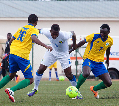 Midfielder Muhamed Mushimiyimana shields the ball from Gabon's striker Ibrahim Mba in the first leg of second round of the AYC qualifiers played yesterday at Kigali Regional stadium. Timothy Kisambira.