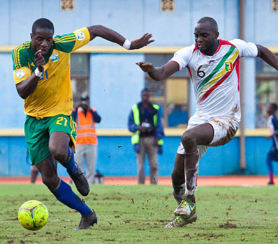 Rwanda's defender Edwin Ouon, left, wheels off as Mali's Muhamed Sissoko chases during a 2014 World Cup qualifier at Amahoro stadium. File.
