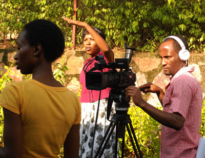 One of the beneficiaries, Espérance Uwimana (centre) directing her film.