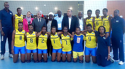 Rwanda U18 girls' team pose with CAVB officials before their game against South Africa. B. Mugabe