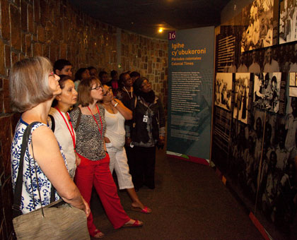 Visitors look at pictures of Genocide victims at Kigali Genocide Memorial Centre in Gisozi. Timothy Kisambira.