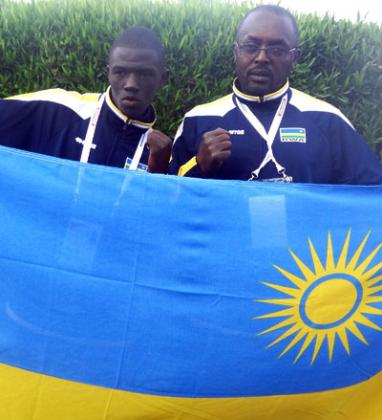 Jean Pierre Cyiza, left and his trainer  Gashugi Kananura after winning a bronze medal for Rwanda on Monday in Gaborone. B. Mugabe