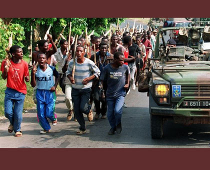 Interahamwe militia scour the streets of Kigali for Tutsi to kill. On the military jeep are former French troops. Net photo.
