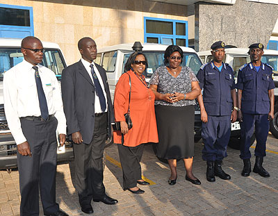 L-R: Warsame, minister Mukantabana, DGIP Nsabimana and  police spokesperson Demas Gatare during the handover  of the vehicles.  Richard Mugarura.