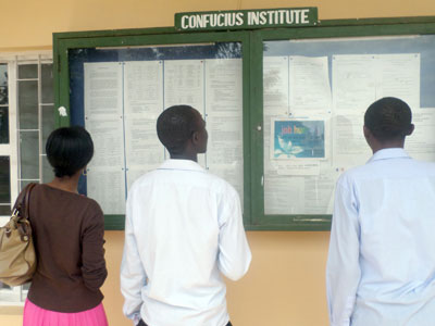 Students check out for their results on the notice board. (Solomon Asaba)