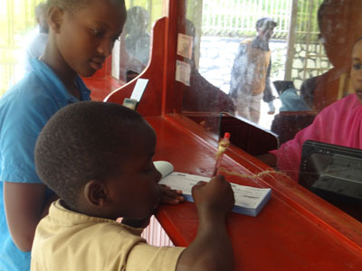 Pupils deposit their savings in a local bank. There are currently thousands of children saving with various financial institutions. (File)