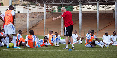 Rwanda national team players listen to their coach Stephen Constantine during a training session ahead of the Afcon qualifier against Libya. T. Kisambira.