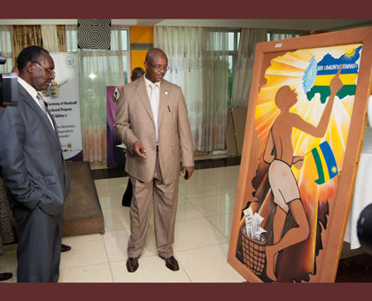 Trade and Industry minister Francois Kanimba (L), looks at one of the art pieces on display during the Craft awards at Lemigo Hotel on Friday. Timothy Kisambira.