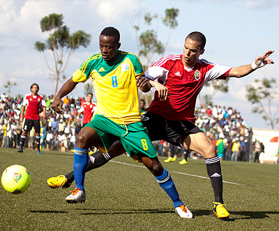 Amavubi skipper Haruna Niyonzima challenges Libya's defender in the first round of the qualifying campaign which Rwanda won 3-0. T. Kisambira