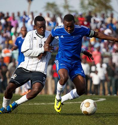 Rayon skipper Fuadi Ndayisenga challenges APR's Charles Tibingana to the ball. Both Rayon and APR will know their opponents today. (Timothy Kisambira)