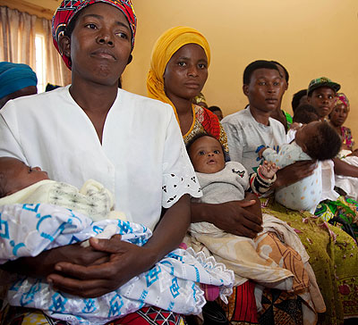 Mothers with their babies at a health centre during a past vaccination event. More Rwandans have increasingly embraced family planning according to research. File.