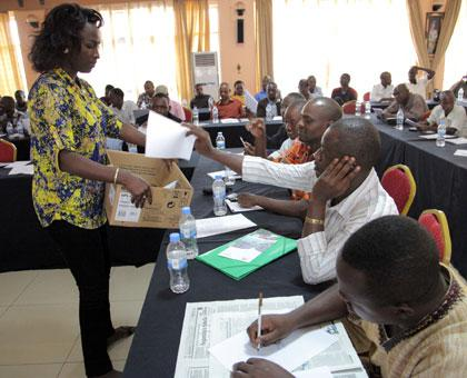 A member of the election committee collects ballot papers during the ARJ elections yesterday. (John Mbanda)