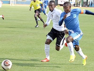 Rayon Sport's skipper Fuadi Ndayisenga attempts to dribble past APR's Michel Rusheshangoga. The two rival sides will take part in the two-week long regional tournament. Courtesy