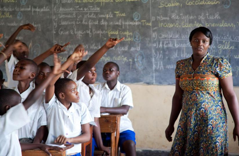 A teacher conducts a lesson at Kimisagara Primary School in the recent past. (File)