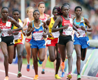 Clémentine Mukandanga (C) finished 10th to set a new personal best in 10,000m, while Claudette Mukasakindi (R) came in 11th position. (Courtesy)