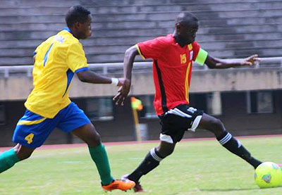 Junior Wasps defender Jean Claude Tuyishime chases Uganda Cubs skipper during the first leg two weeks ago in Kampala. Rwanda needs to win 5-0 to progress to next round. Courtesy.