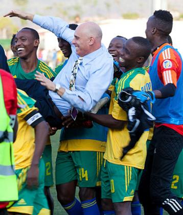 Head coach Stephen Constantine is lifted shoulder high by players after Rwanda defeated Congo on Saturday. T. Kisambira
