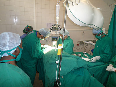 Rotary Medical Mission members carry out urologic surgery on a patient at Chuk.  Ivan Ngoboka.