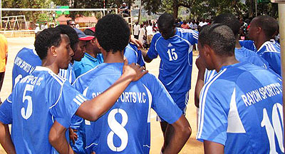 Rayon Sports Volleyball players listen to their coach. File