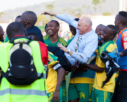 Constantine was carried aloft by his players after Rwanda beat Congo to qualify for the group stage of Afcon-Morocco 2015 finals. (Timothy Kisambira)