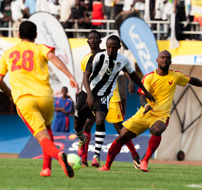 APR midfielder Andrew Buteera tries to go past three El Merreikh players during the final on Sunday. T. Kisambira