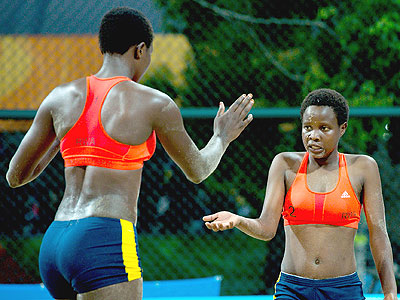 Seraphine Mukantambara, left , and Lea Uwimbabazi celebrate winning a set during their victory over Argentina. Courtesy