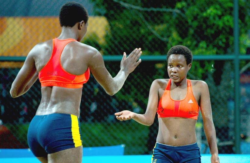 Seraphine Mukantambara, left , and Lea Uwimbabazi celebrate winning a set during their victory over Argentina. (Courtesy)