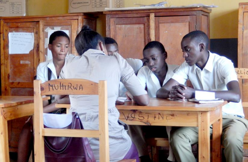 Students having a discussion at school. Late comers may miss out on such useful activities. (Solomon Asaba)