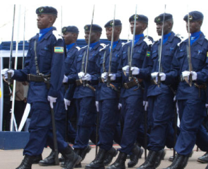 Police officers march during a past parade. Rationalising the law and order sector through a merger of the different organs was more viable for it allowed for common training, unified command and control; and the consolidation of resources and equipment.File.