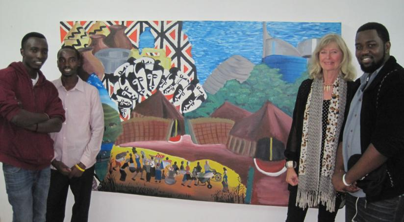 Anne Holmes, 2nd right, poses with the art students next to the main picture of the exhibition. (Courtesy photo)