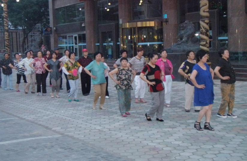 Senior citizens perform the disco dance to stay fit on a street in Ningxia. (Paul Ntambara)