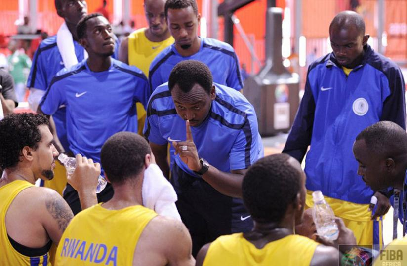 Head coach Moise Mutokambali gives tips to his players in a past continental tournament. (Courtesy)