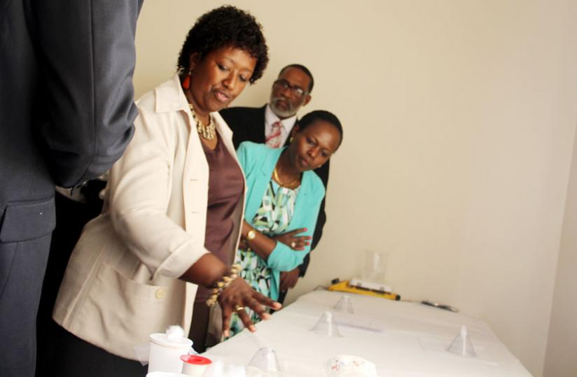 The Minister for Health, Dr Agnes Binagwaho (L) assesses an entomology equipment in the new lab. Courtesy.