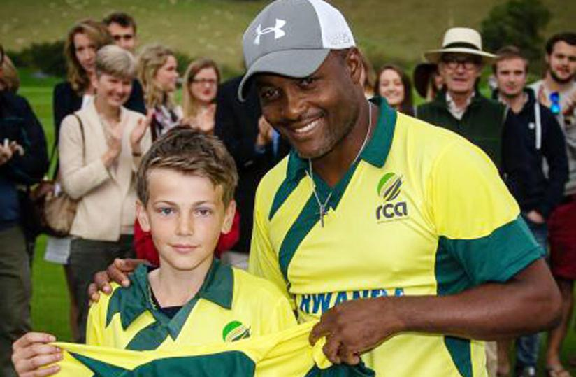 Brian Lara (left) with cricket fan Dee Jarvis at the end of the charity match played on Monday. (Courtesy photo)