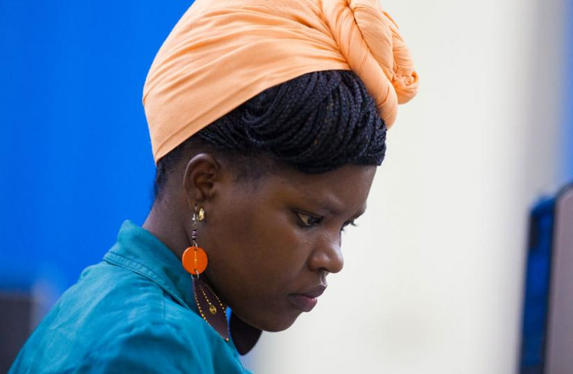 A scarf can also be worn on the head. (Timothy Kisambira )
