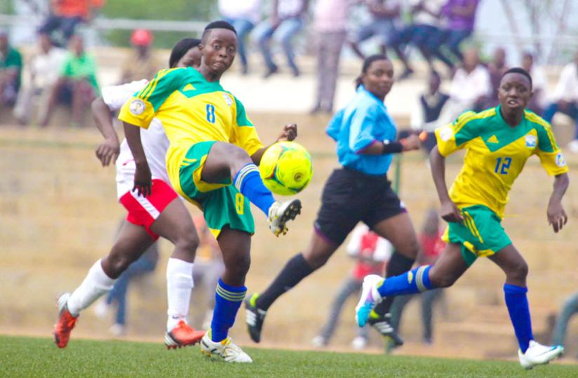 THIS IS HOW WE DO IT: A player of the National Women's Football team controls the ball during a match. (File photo)