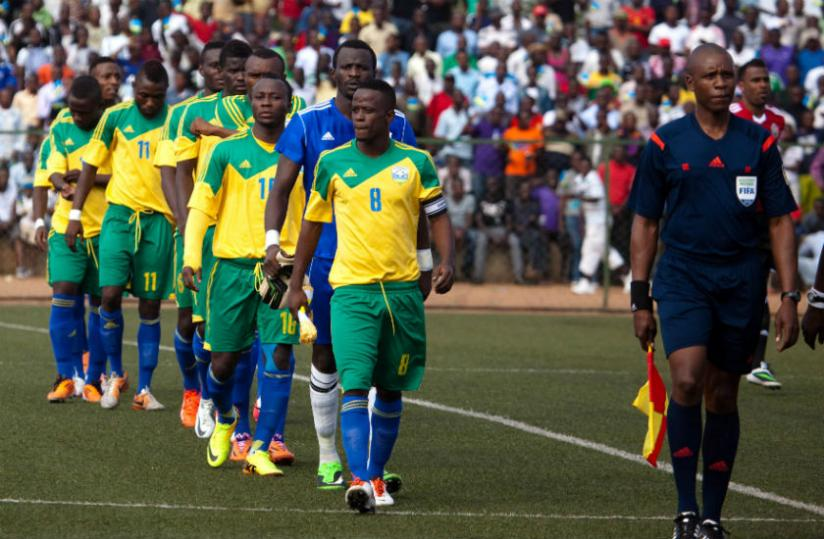 Amavubi's captain Haruna Niyonzima leads his teammates to the field for the 2015 Afcon Qualifier against Congo last month. (Timothy Kisambira)