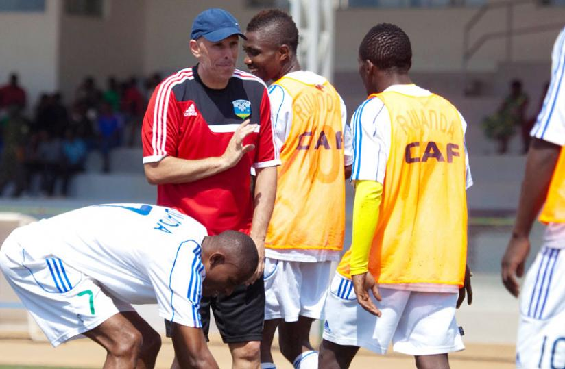 Talking tactics: Amavubi coach Stephen Constantine with his players during a training session. (T. Kisambira)