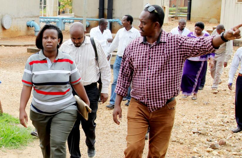 State Minister for Water and Energy Germaine Kamayirese (L) is taken around Nzove Water Treatment Plant in Kimisagara by Water and Sanitation Corporation managing director James Sano on Wednesday. (John Mbanda)
