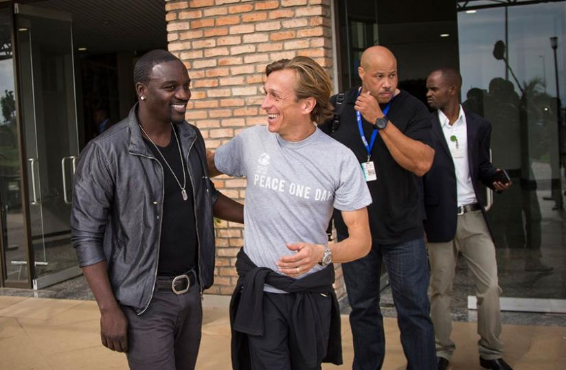 Senegalese-American star Akon is received by Peace One Day officials. (Plaisir Muzogeye)