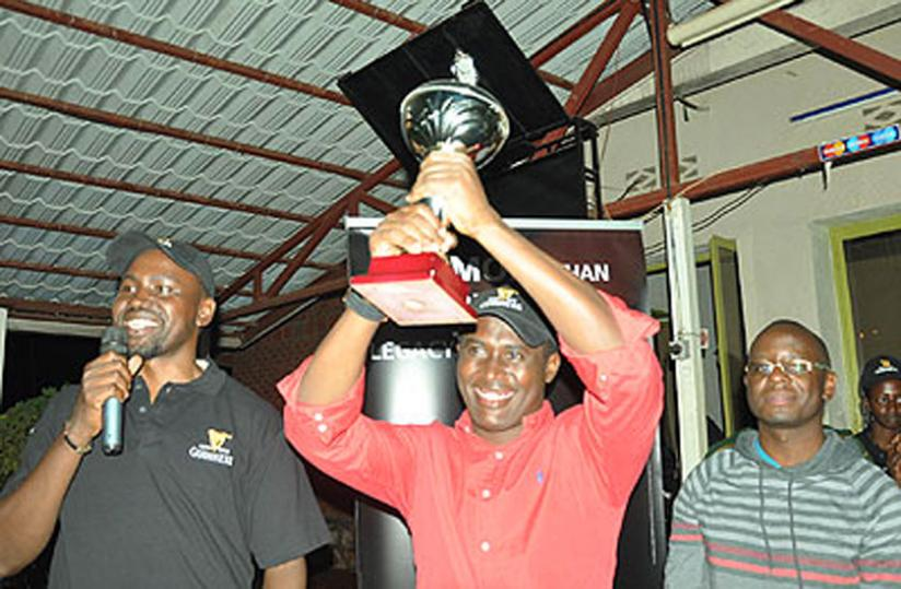 Kigali Golf club president Dr. Richard Gakuba recieves the trophy in February. (File photo)