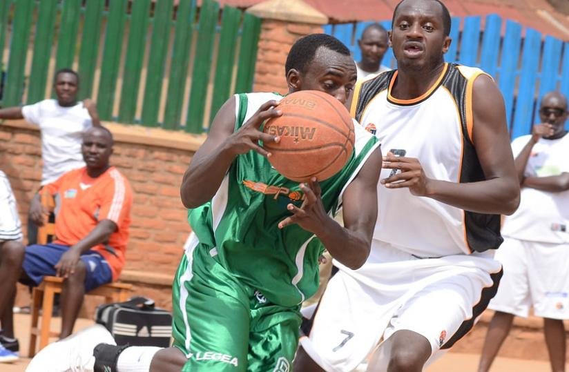 Espoir captain Aristide Mugabe (L) seen here in action during a local league game against APR, will be one of Rwanda's key players against Uganda. (File photo)