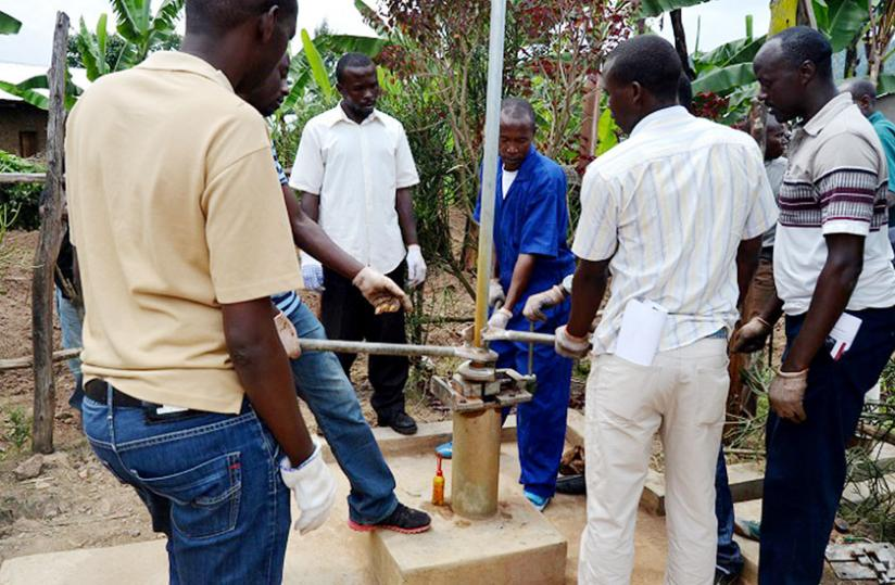 Residents from three districts acquire skills on how to maintain a borehole in Musanze District last week.  (Jean d'Amour Mbonyinshuti)