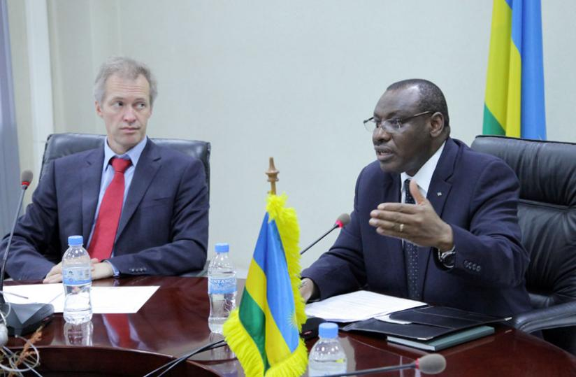 Finance and Economic Planning minister Claver Gatete (R) briefs the media at the signing ceremony in Kigali yesterday as Belgian ambassador to Rwanda Arnout Pauwels looks on. (John Mbanda)