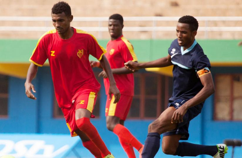 Police FC skipper Moussa Mutuyimana, right, seen here playing against El Merreikh during the Cecafa Kagame Cup 2014, says Rayon must meet his demands first. (File)