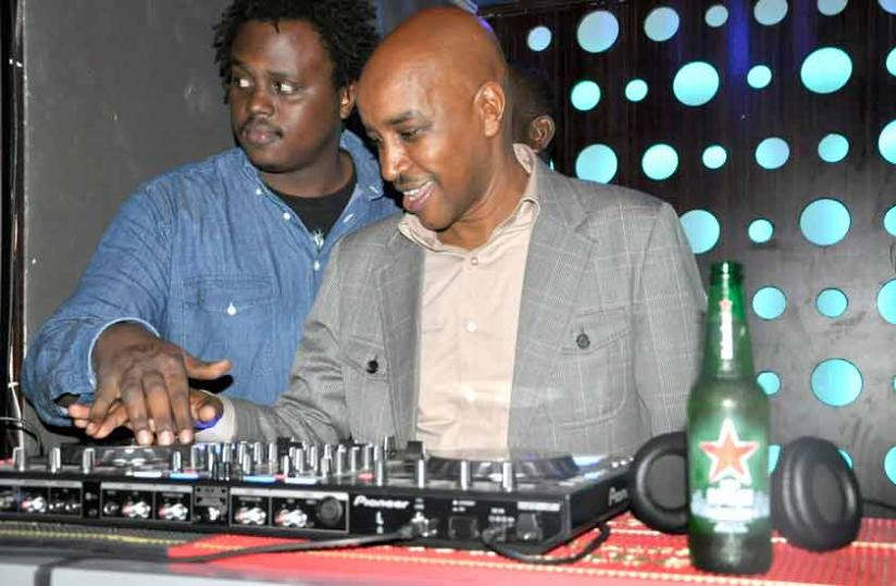 Nkurunziza (right) tries out the wheels of steel.