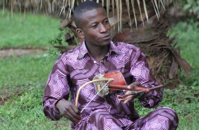 Hyacinth Hageni performs with a traditional music instrument.  Photo (Stephen Kalimba)