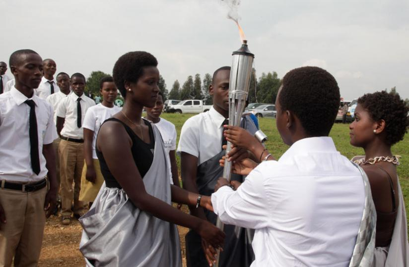 The Genocide remembrance torch being delivered in Nyange, Karongi District, earlier this year. (File)
