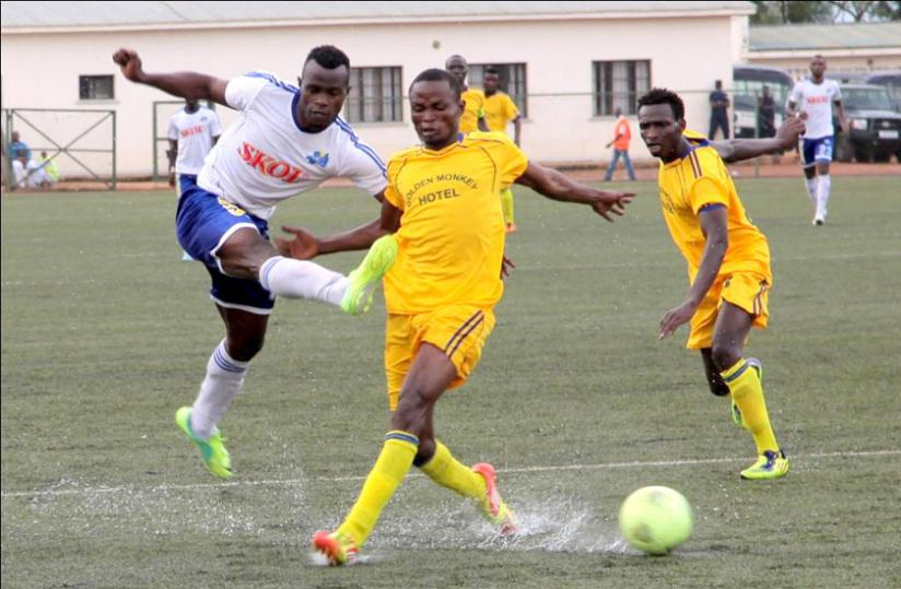 Goal scorer Peter Otema (L) attempts to go past Amagaju defender Joachim Alanga in the opening game of the season yesterday at Stade de Kigali. (John Mbanda)